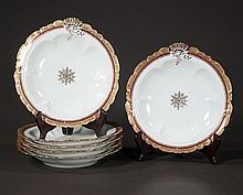 Set of six Limoges china oyster plates with gold band and shell decoration, 10