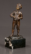 Continental bronze depicting young boy in knee-breeches on a black marble base, 11