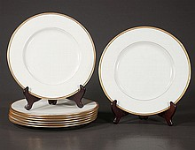 Set of eight Lenox china dinner plates with gold band decoration, made for