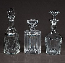 Group of three cut crystal decanters, two with sterling silver labels, one signed