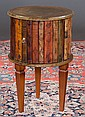 Sheraton style circular side table with leather bound top, book bindings around the sides and on square tapered legs, 16