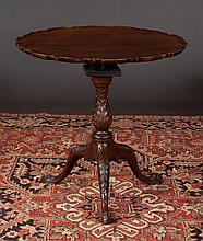 Chippendale style mahogany bird cage tip table with scalloped pie crust top, base has acanthus leaf carved column and cabriole legs with ball and claw feet, c.1830, 29
