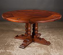 Circular walnut library or dining table with fleur-di- leis carved top, base has four columns with four legs, 60