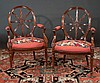 Pair of Sheraton style mahogany armchairs with wheel shape backs, needlepoint seats and fluted tapered legs, 24