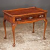 Mahogany tea table with shaped gallery edge above frieze drawer on cabriole legs with pad feet, 32