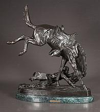 Western bronze sculpture of a horse and his rider on the ground