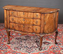 Queen Anne walnut block front commode with cross-banded top, three drawers in the center and cupboard doors and on cabriole legs with pad feet, c.1880, 51