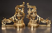 Pair of Louis XV style bronze chenet having scrolling acanthus decoration with urn surmounts, 16