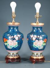 Pair of Chinese cloisonn_ urns with multi color floral decoration, mounted on wooden stands and adapted as lamps, 31
