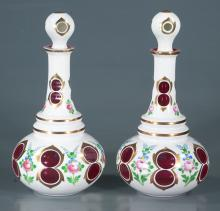 Pair of Bohemian cranberry overlay decanters with multicolor floral decoration, 12