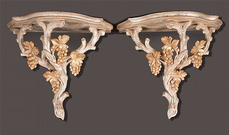 Pair of carved gold gilt wall brackets with leaf and grape decoration, 17