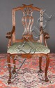 18th century Portuguese armchair with scroll and ribbon carved back, scroll carved arms and cabriole legs with ball and claw feet,  26