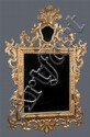 18th century 24 kt. gold leaf Venetian mirror with Phoenix birds and carved flower decoration in relief, 77