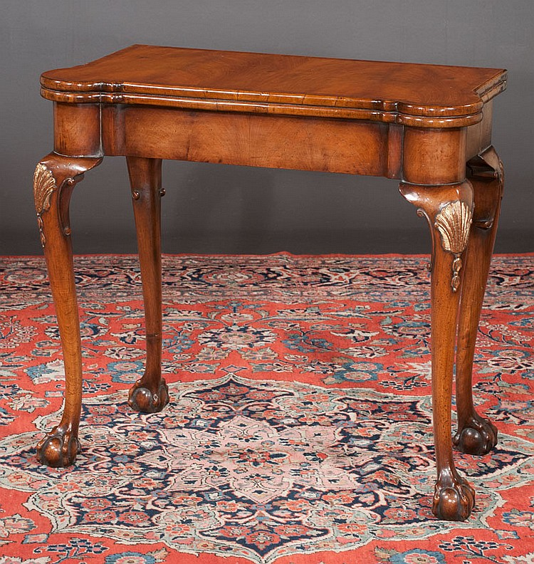 Chippendale walnut lift top game table with cross-banded top, concertina action, cabriole legs with shell carved knees and ball and claw feet, c.1890, 31
