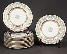 Set of 11 fancy china dinner plates with green and gold band decoration, marked