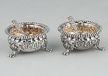 Pair of sterling silver footed salt cellars in the Repousse pattern, marked