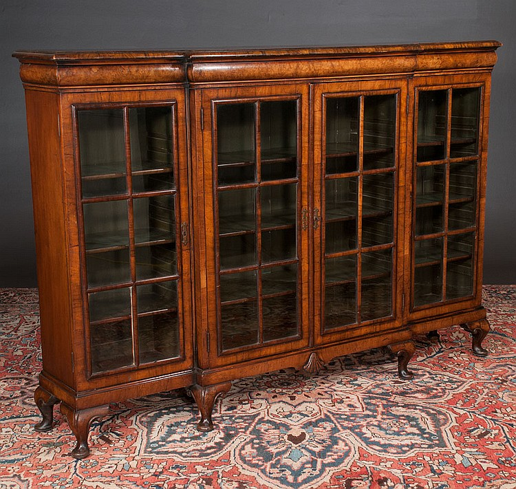 Queen Anne style walnut breakfront bookcase with moulded cornice, mullion glass doors, short cabriole legs and pad feet, c.1890, 72