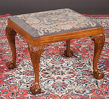 Chippendale mahogany stool with needlepoint cushion, cabriole legs, acanthus carved knees and ball and claw feet, c.1880, 28