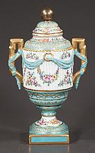 """French porcelain urn with gold gilt handles, drape and floral decoration, 13"""" high"""