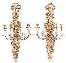 """Pair of gold gilt five branch wall sconce with ribbon pediment and sheaves of wheat and musical instruments, 44"""" high, 19"""" wide"""