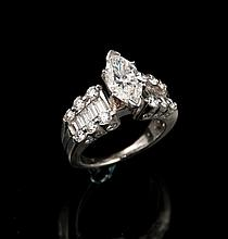 Platinum ring with a center marquise cut diamond, approx. 1.60 ctw. and having round brilliant and baguette diamonds set on shoulders of ring, approx. 1.25 ctw.
