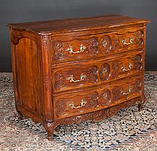 "Chestnut and oak serpentine front country French commode with carved drawer fronts and carved apron, c.1830, 47"" wide, 25.5"" deep, 37"" high"