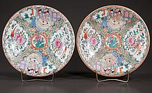 "Pair of Chinese Rose Medallion chargers with figural, floral and bird decorations, 12"" diameter"