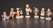 Group of seven Hummel porcelain figures