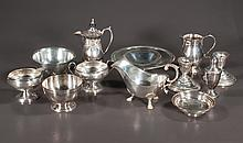 Sterling silver cream and sugar bowl, As Found, pair of sterling silver candlesticks, sterling footed bowl, one sterling silver salt shaker and six pieces of assorted silver plate, 12 pieces