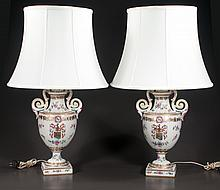 "Pair of French style porcelain urns with scroll handles and multicolor floral decorations mounted as lamps, 29"" high"