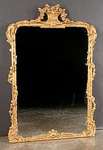 "Gold gilt carved wood Venetian style mirror with urn, leaf and floral carved pediment and floral carved sides by Carver's Guild, 58"" high, 38"" wide"