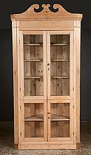 """Country pine corner cupboard with broken arch pediment with glazed doors and moulded base, c.1890, 46"""" wide, 31"""" deep, 96.5"""" high"""