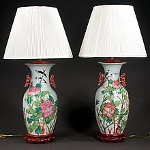 """Pair of Chinese porcelain vases with multicolor bird, leaf and floral decorations adapted as lamps on teakwood stands, c. 1900, 32"""" high"""