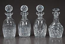 """Group of four signed Waterford cut glass decanters with cut glass stoppers, 10"""" high"""
