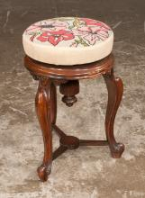 Walnut circular stool with adjustable seat, the seat having needlepoint tapestry on three cabriole legs on scroll feet, 12