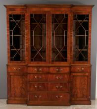 Sheraton design mahogany breakfront bookcase with dentil crown moulding, mullion glass doors, center has two small drawers over three full graduated drawers, each end has one drawer over a panelled door, 75