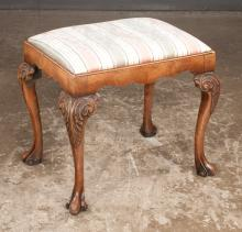Queen Anne walnut foot stool with shaped apron, cabriole legs with acanthus leaf carved knees and shaped scroll pad feet, c.1900, 22