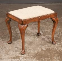 Queen Anne walnut foot stool with carved knees, upholstered slip cushion on cabriole legs on pad feet, c.1900, 22.5