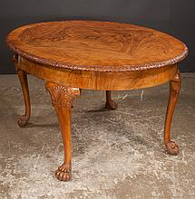 Chippendale style  walnut extending dining table with cross-banded and carved top, cabriole legs, shell carved knees and hairy paw feet, c.1900, 62