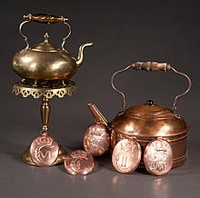 English brass tea kettle, a brass trivet, a copper tea kettle and five oval copper coat of arms from Denmark, eight pieces