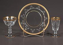 Collection of crystal with gold band decoration, 12 plates, 12 champagnes and 11 small wines, 35 pieces