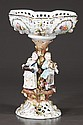 German porcelain center piece with filigree bowl at the top supported by four figures playing musical instruments, c.1900, 8