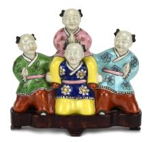 Porcelain Figure of Four Boys with a Stand