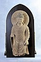 A LARGE POLYCHROME GANDHARAN STUCCO STANDING FIGURE OF BUDDHA