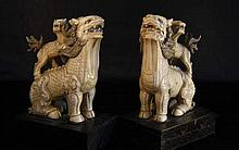A PAIR OF IMPRESSIVE LARGE MING DYNASTY IVORY FIGURES OF FOO DOGS (SHI LIONS 獅)