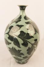 Asian Porcelain Celadon vase decorated all around with vines and flowers signed illeg