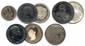 Lot de quatre monnaies-boites à secret en argent et une monnaie satirique du XIXe siècle.  T.B.