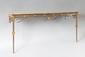 CONSOLE de forme rectangulaire, en acier poli et bronze doré. La ceinture agrémentée de volutes, de mascarons, et de pastilles. Elle est décorée de triglyphes et repose sur des pieds fuselés à chapiteaux terminés par des sabots. Fin du XVIIIème-début