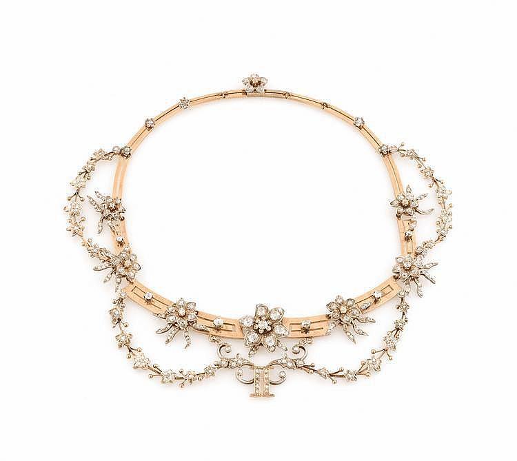 COLLIER DRAPERIE en or jaune et argent, stylisant des guirlandes de fleurs ornées de diamants de taille ancienne, décor de fleurs amovible, d'époque Napoléon III. Poids brut : 100,5 g Dans son écrin A YELOW GOLD, SILVER NECKLACE, NAPOLEON III