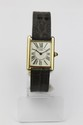 CARTIER MUST  MONTRE en vermeil, le cadran rectangulaire, index et chiffres romain.  A steel and yellow gold winding wirstwatch by Cartier